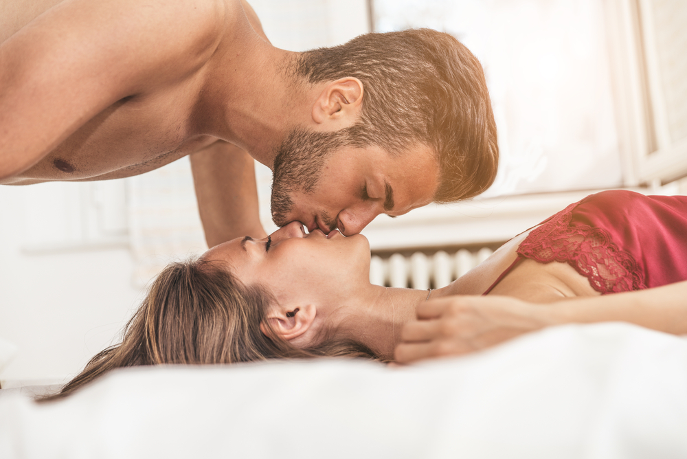 Young beautiful couple on a bed - Libra man in bed